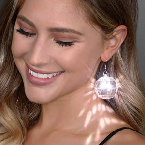 Woman displaying Light Projecting Disco Ball LED Earrings