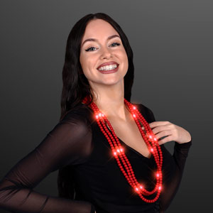 Woman displaying Light Up Red Beaded Necklace, No-Flash