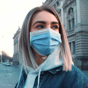 Woman wearing Blue Pleated Face Mask