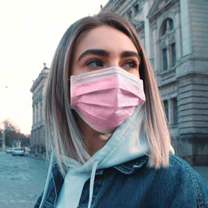 Woman wearing Pink Pleated Face Mask