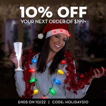 Woman celebrating the winter holidays with light up christmas wearables
