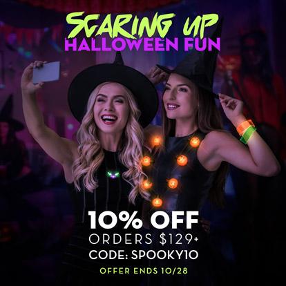 Women enjoying Halloween party wearing Light Up Wearables.