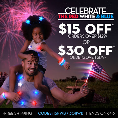 Father and daughter celebrating 4th of July with light up headwear, necklaces, and flags