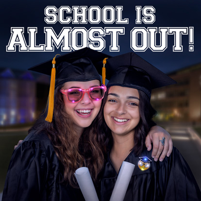 Two girls graduating with light up products