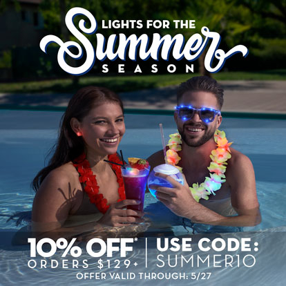 Couple in pool with light up drinkware and wearables